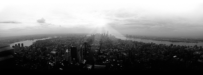 a black and white shot of a sprawling cityscape