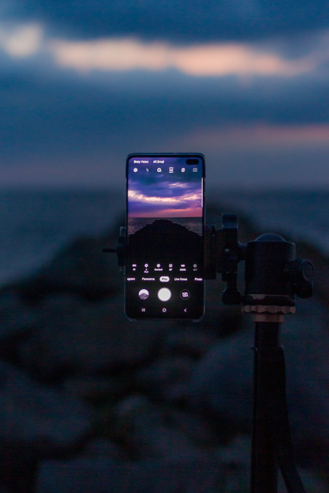 a smartphone on a tripod capturing a glorious sunset