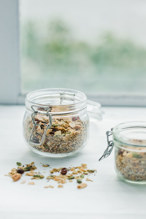 Photo of a jar of oats in front of a window