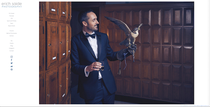 Photo of an elegantly dressed male model with a falcon in his hand by Erich Saide