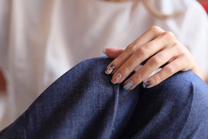 cool nail photography of a female models hands highlighting nail art