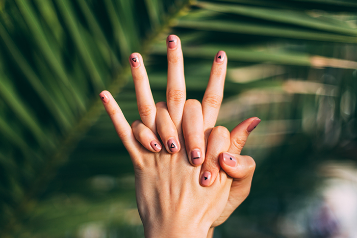 cool nail photography of a female models hands with painted nails