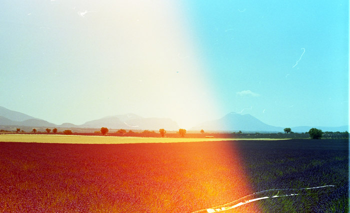 Photo of a landscape with the left side of the photo in red hue