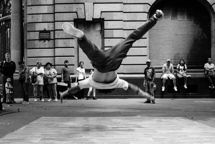 a portrait of a street performer mid-jump