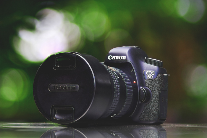 A Canon DSLR fitted with a Tokina lens