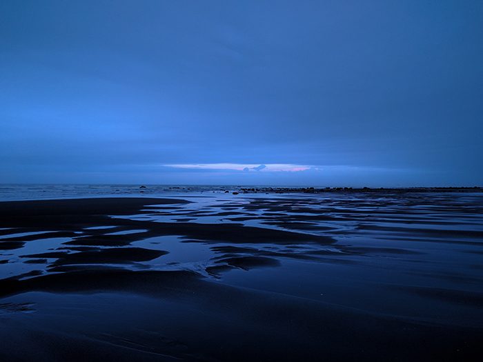 Photo of a waterscape at blue hour in soft blue light