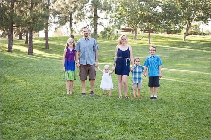 lifestyle portrait of a family with young kids demonstrating good ways to photograph unruly children