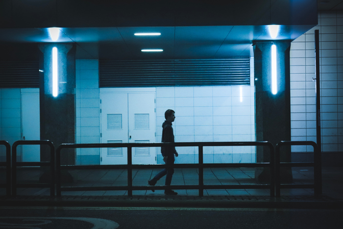 Silhouette of a man walking inside a building