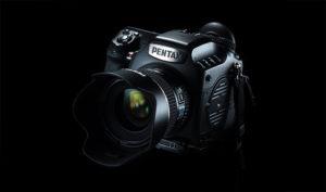 A Pentax camera on a black background