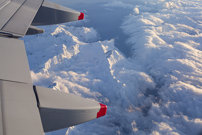 Photo of mountains with snowy tops shot from an airplane