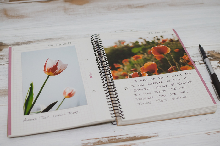 notebook, photos and stationary for making a photo journal