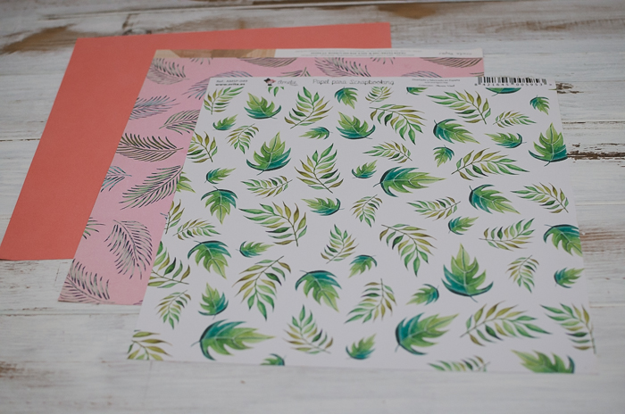 three sheets of different colorful papers for scrapbooking creations