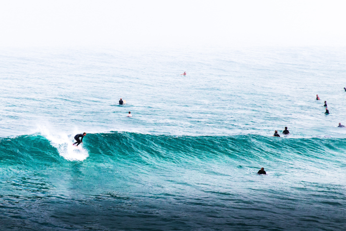 Photo of surfers riding a wave