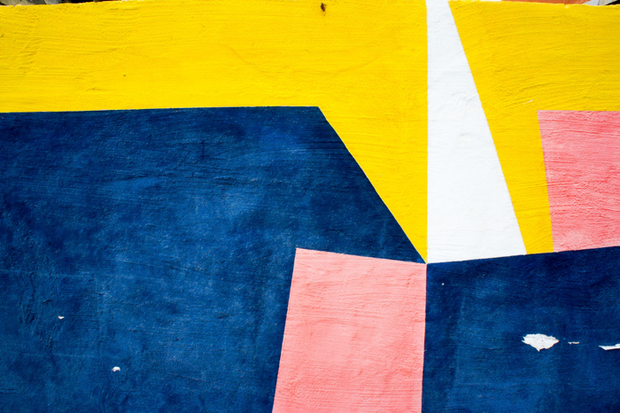 a wall painted in abstract colors in geometric pattern