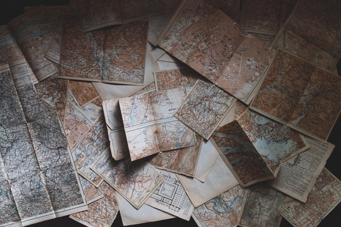 Photo of oldschool maps spread on a table
