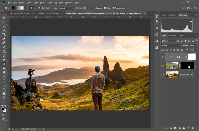 The image of the person has been edited and now blends into the landscape scene better.