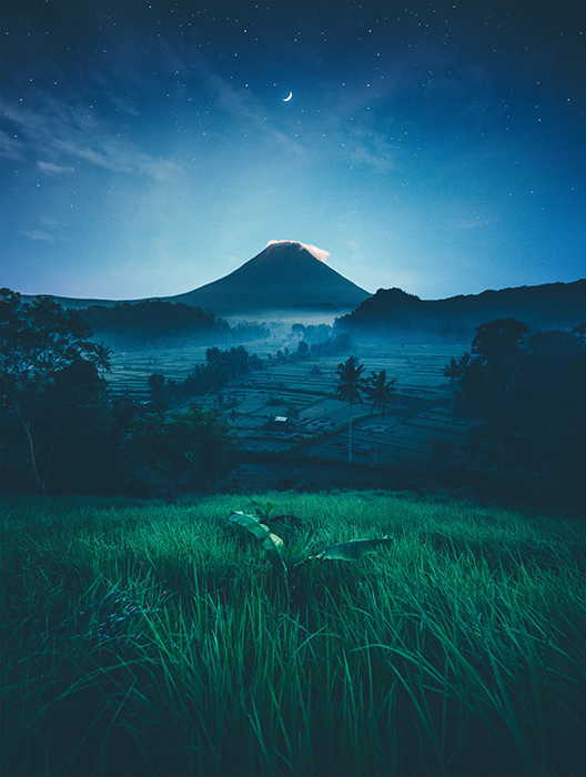 Photo of a landscape at night with softer blue tones