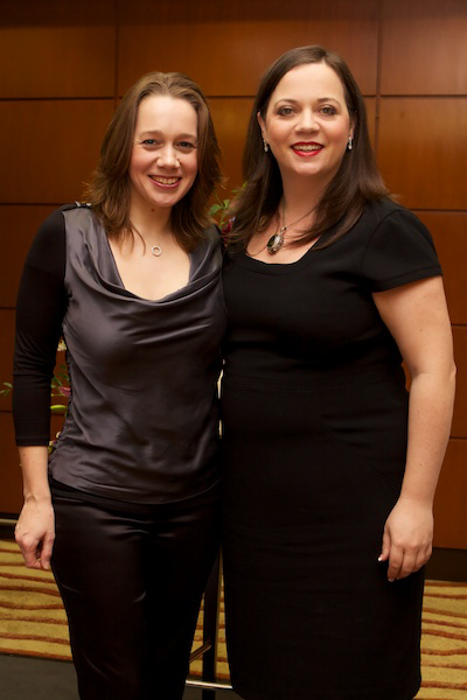 a portrait of two women in formal wear