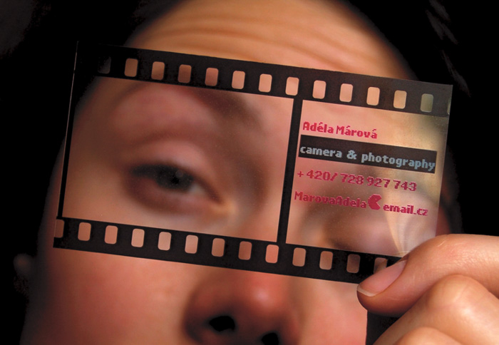 a person holding a photography business card to her face