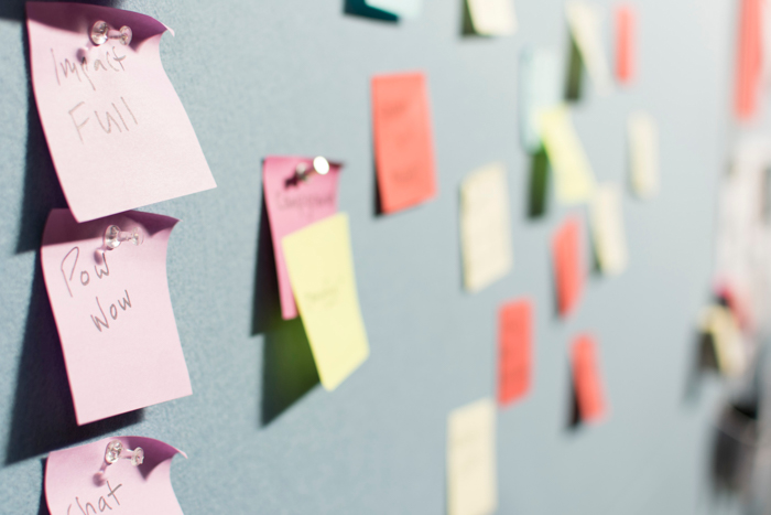 different colored post it notes pinned to a wall