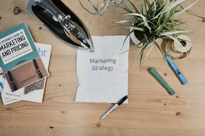an overhead shot of photography business marketing books and materials