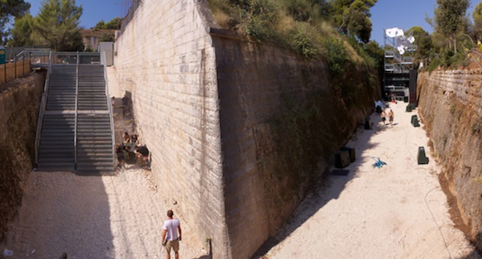 a high angle shot of people walking through concrete paths