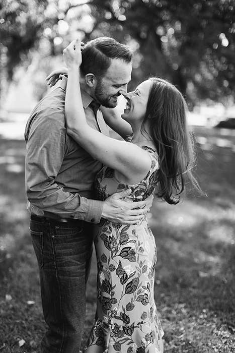black and white portrait of a couple hugging and rubbing noses