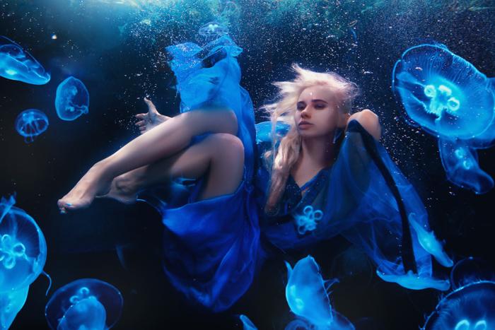a fantasy portrait of a fairy female underwater