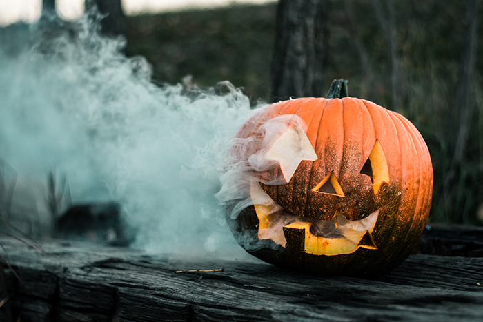 photo of a Halloween pumpkin with smoke coming out of it