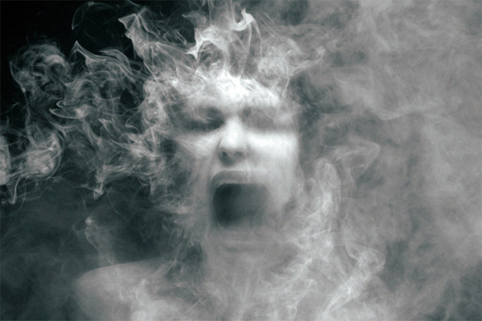 Black and white photo of a ghost-like face screaming