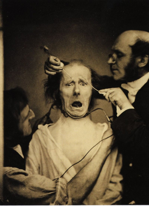 Horror photo of a patient and a doctor treating him in sepia