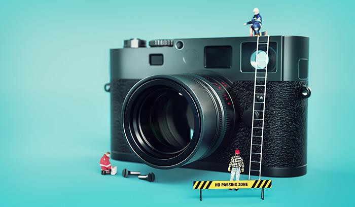 A camera with miniature figurines around it
