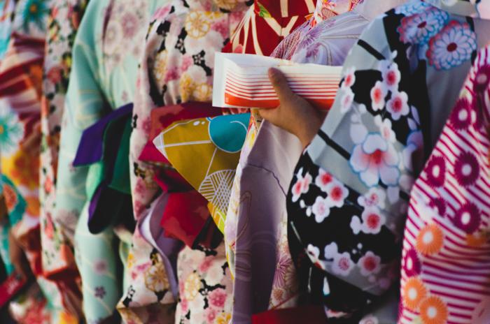A row of brightly coloured kimonos