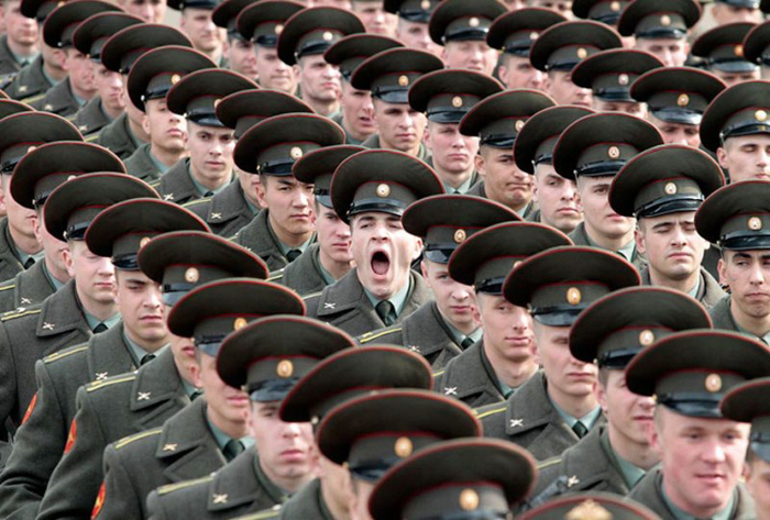 Photo of a soldier yawning in the line