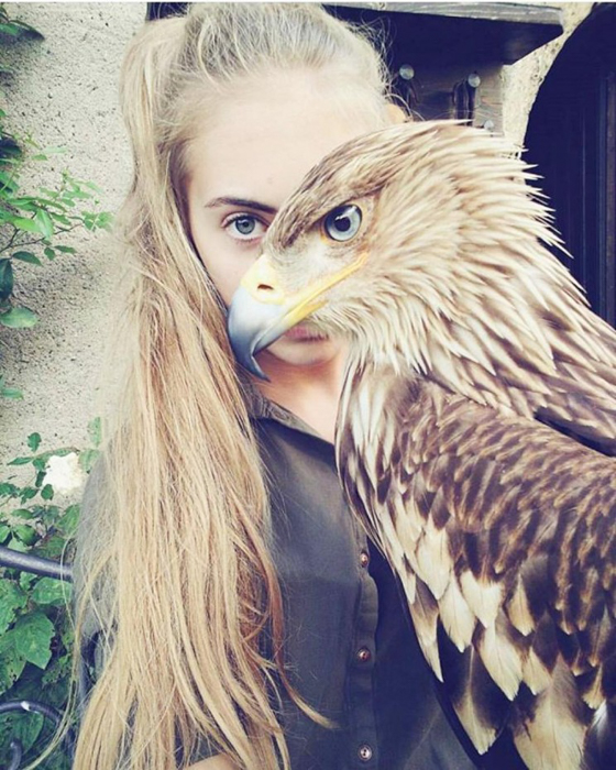 Photo of a girl with an eagle covering half of her face
