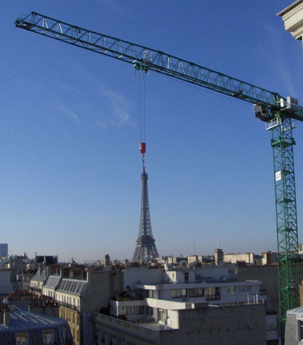 Photo of a crane looking like it's holding the Eiffel Tower