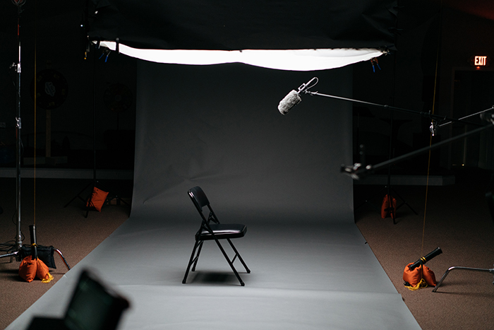 Photo of a photography studio setup with a chair in the middle
