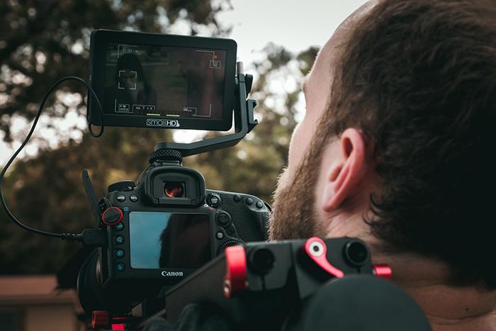 Man looking at the digital display of a camera