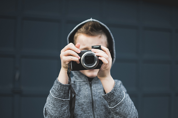 Photo of a little boy with a camera