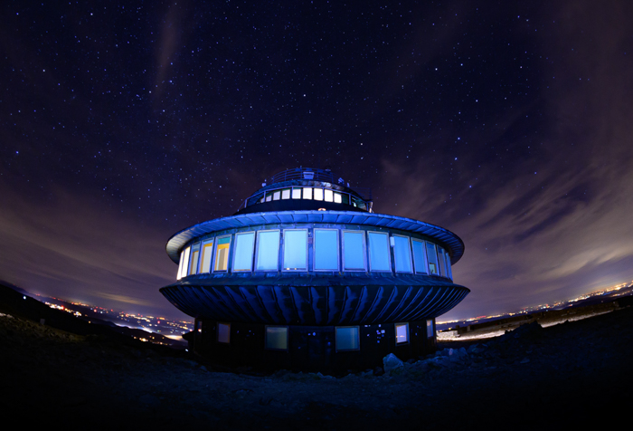 Panoramic photo of a round-shaped building during nighttime