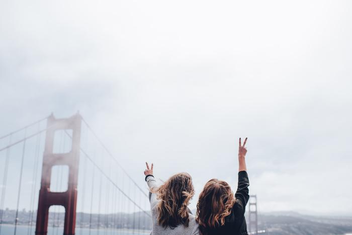 Photo of girls posing at the Golden Gate Bridge