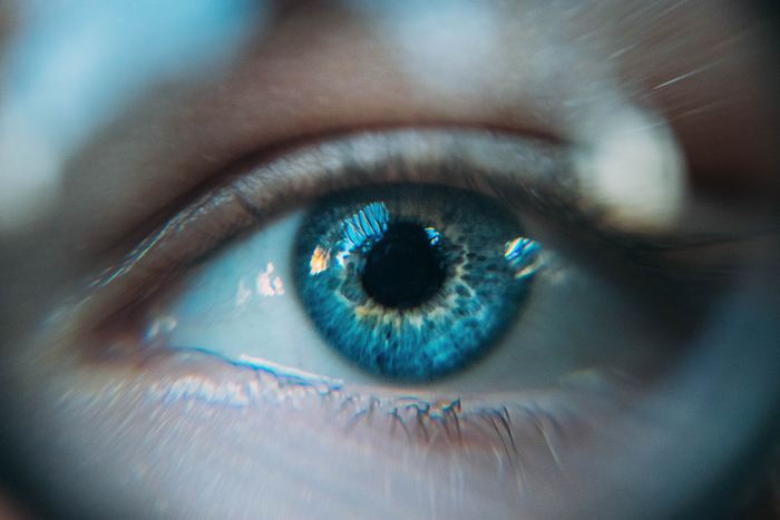 a close up photo of a persons blue eye