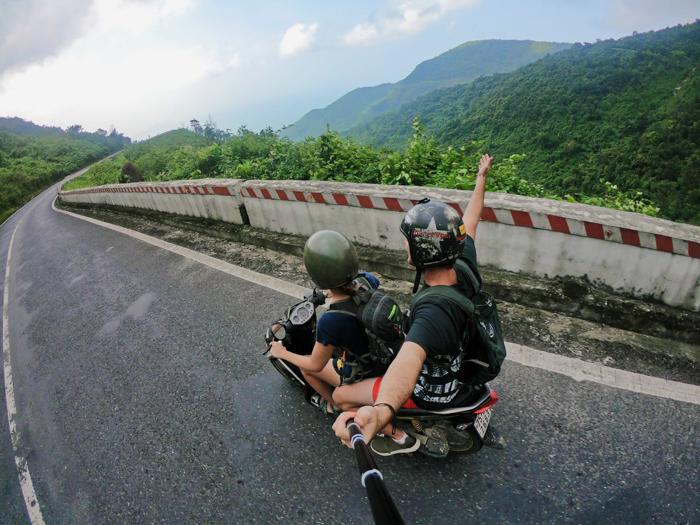 Shot of a couple on a motorbike taken using a selfie stick
