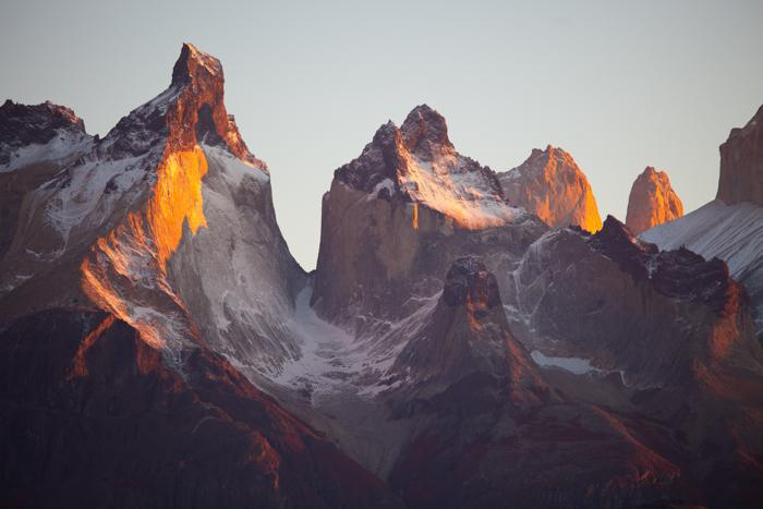 Alpenglow photo of a mountain peak reflecting the sunlight