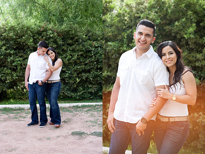 A couple standing in a garden shot with the arm hold pose