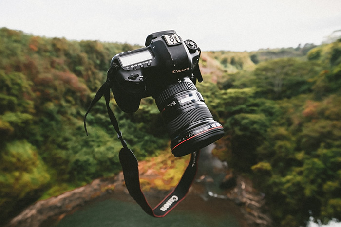 A Canon camera suspended in the air