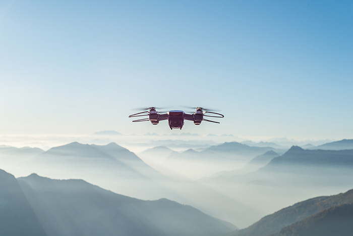 A drone flying over mountains