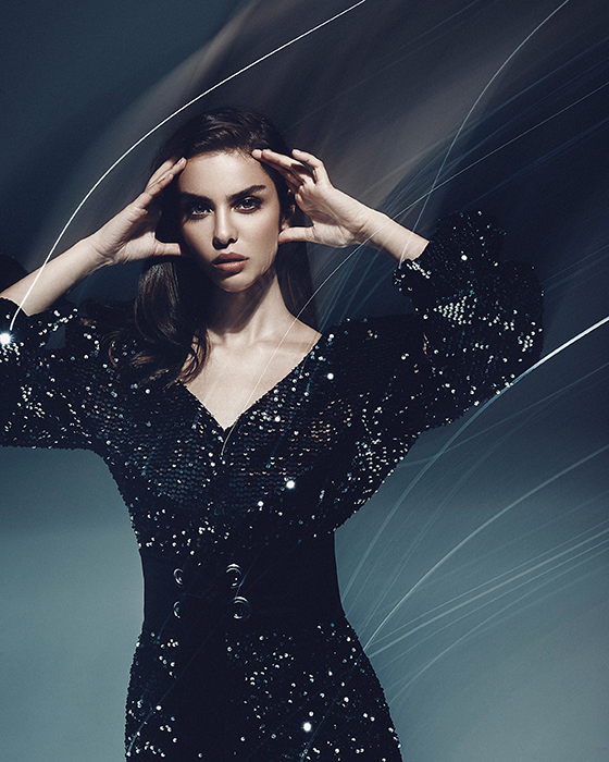Portrait photo of a model dressed in a black sequin dress