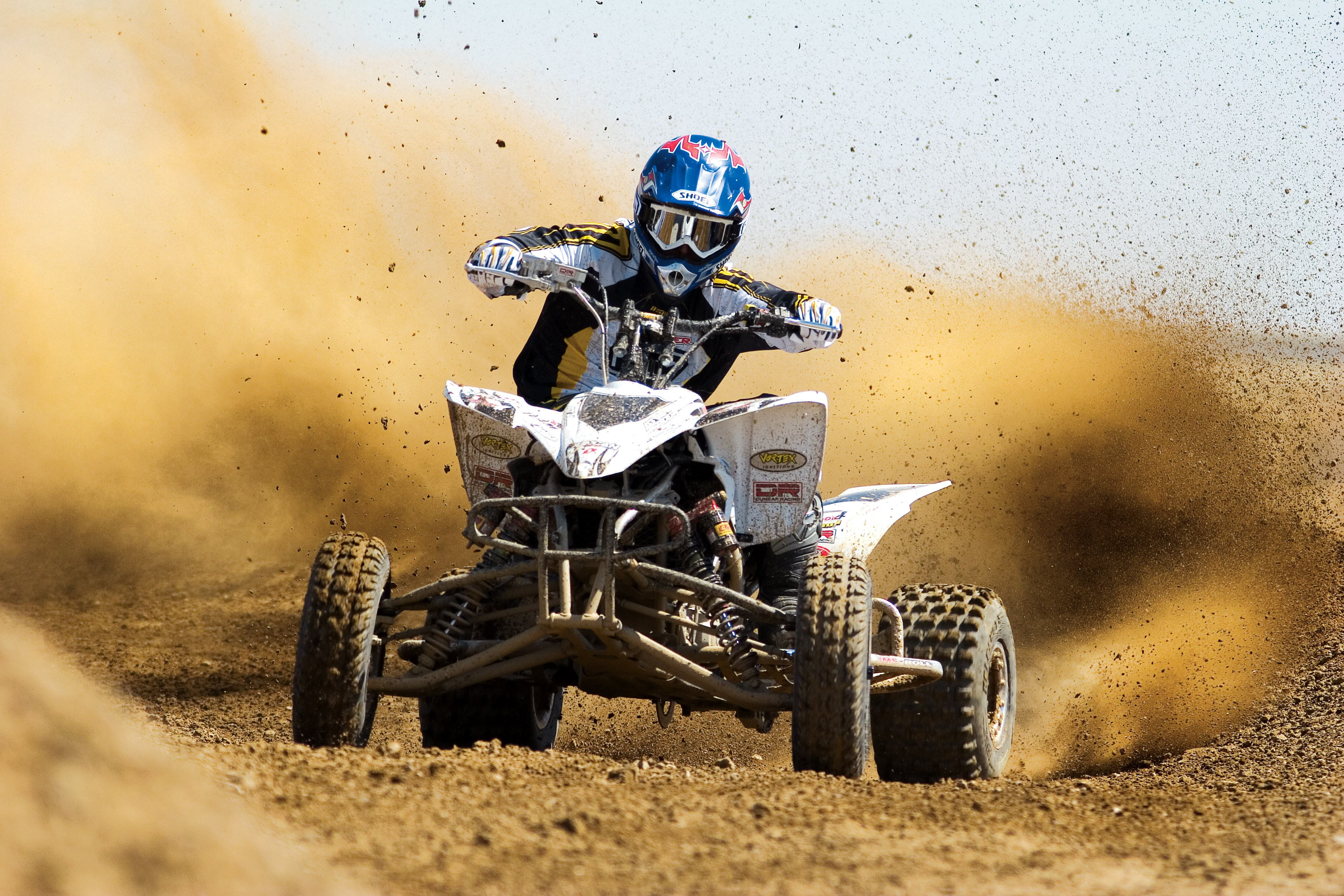 Photo of a quad racer in the sand