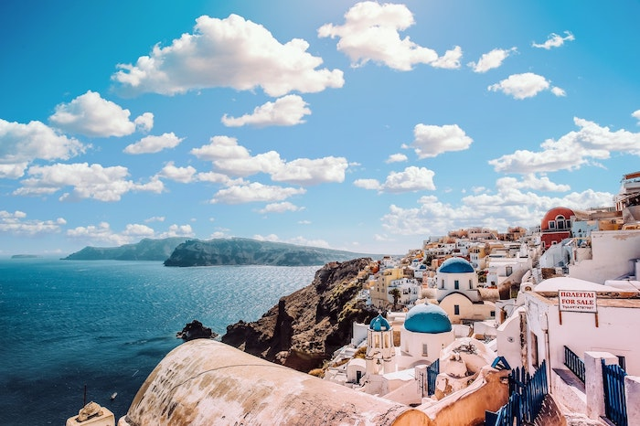 An edited image of a Greek seaside town